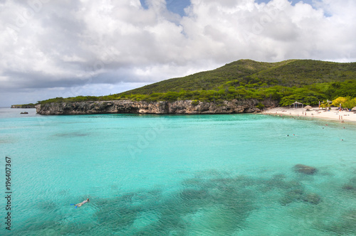Fotobehang Tropical strand Turquoise Caribbean water and secluded beach