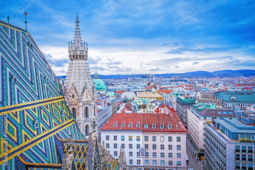Foto op Canvas Wenen Lovely view from above of Vienna - the capital of Austria, European country. Iconic landmark and extremely popular European travel destination. View over roofs on classic architecture, day scenery.