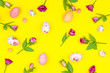 Happy Easter concept. Pattern colorful spring's flowers and colorful easter eggs on yellow background