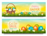 Two Easter Sale banners. Colorful eggs in green grass. Vector. - 196432771