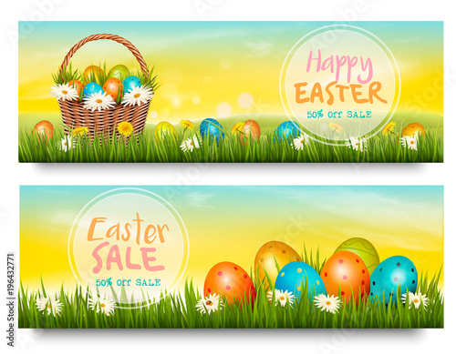Two Easter Sale banners. Colorful eggs in green grass. Vector.