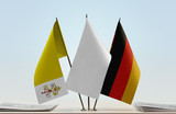 Flags of Vatican City and Germany with a white flag in the middle - 196434150