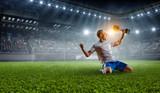 Soccer player at stadium. Mixed media - 196443518