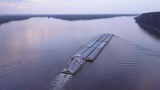 A beautiful aerial of a barge traveling on the Mississippi River. - 196443704