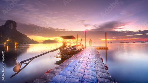 Plexiglas Thailand Tropical tranquil shore and pier in rays of dawn