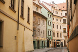 A beautiful street with traditional houses in Prague in the Czech Republic.