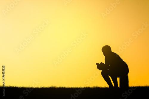 Fotobehang Zwavel geel Child read a book silhouette.
