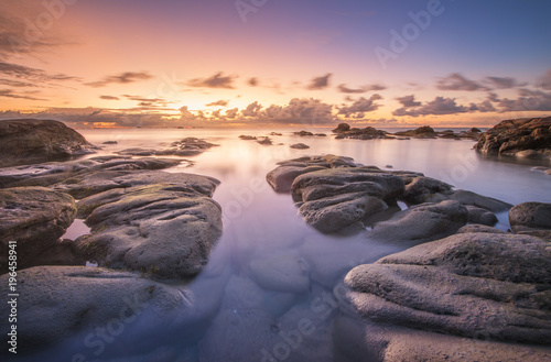Fotobehang Lavendel Long expose seascape with stunning sunset colors.