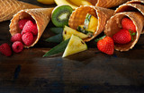Fresh tropical fruit in waffle cones