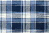 Blue checkered fabric close-up. Texture