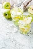 Sour Apple Cocktail or Infused detox water, cold summer drink. on grey stone table copy space