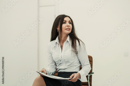 Foto Murales portrait of business woman with documents and financial charts s