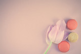 Flat lay of macaroons and Pink tulip with petals