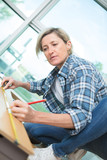 female carpenter marking the right spot - 196495178