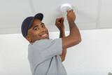 Man fitting smoke detector - 196498127