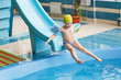 GRODNO, Belarus - Health resort Porechye. Children skiing with a water slide swimming in the pool.