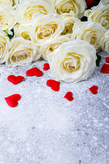 White Rose Bouquet  on a stone background Holiday Background Valentine's Day Heart Shape Top View