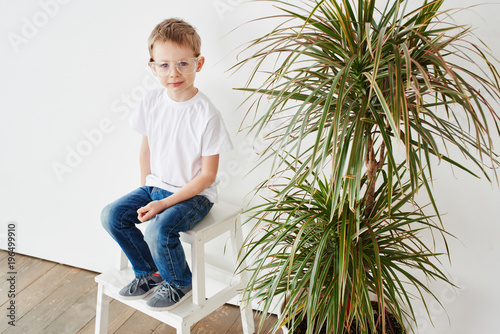 Portrait of a pensive little guy on a white background Poster