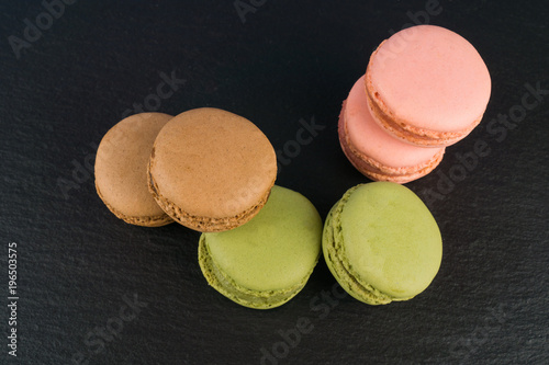 Delicious macaron on black background Poster