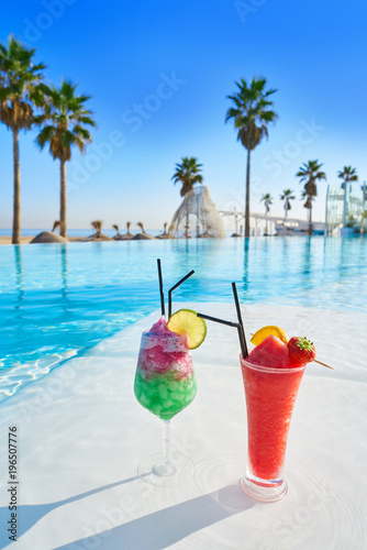 Tropical cocktails in resort infinity pool