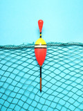 Fishing net with bobber on blue background. Picture with space for your text. - 196513315