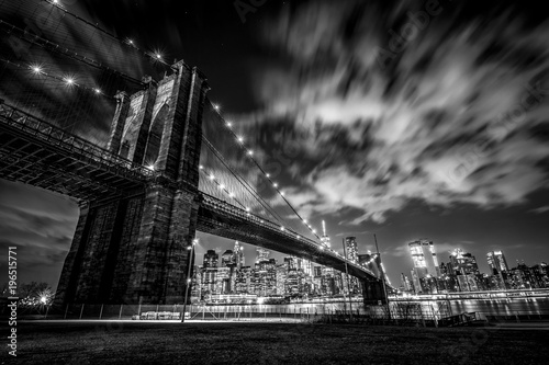 Under the Brooklyn Bridge loooking at New York City skyline (B&W)