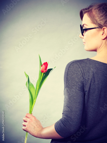 Elegant woman with flower.
