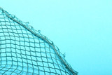 Fishing net on blue background. Picture with space for your text. - 196525923