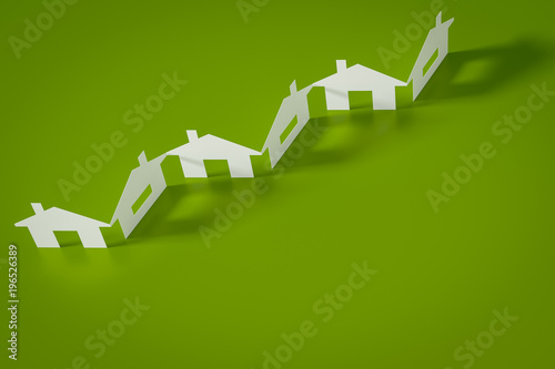 a paper cutout row of houses green background - 196526389