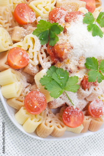 Colorful pasta with tomato sauce and cheese - 196528147