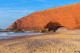 Sandstone arch at Legzira beach, Morocco - 196533356