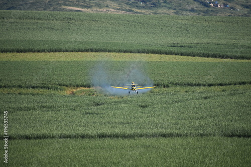 Foto op Aluminium Khaki An Anti-Pest Blast. Disinfecting The Landscape For A Healthier Crop And Harvest.