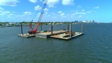 Construction crane on a barge in water 4k 60p - 196534362