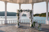 Wedding ceremony arch it the beautiful lake place. Details of decoration - 196552175