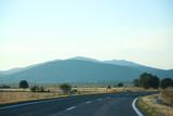 Road through rural landscape at sunset - 196553559