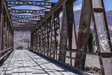 Perspective metal bridge into the mountains