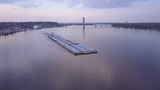 A beautiful aerial of a barge traveling on the Mississippi River. - 196570199