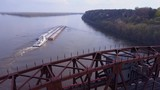 A beautiful aerial of a barge traveling under a steel drawbridge on the Mississippi River. - 196574158