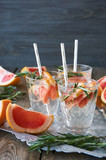 Detox water with grapefruit and rosemary on a tray