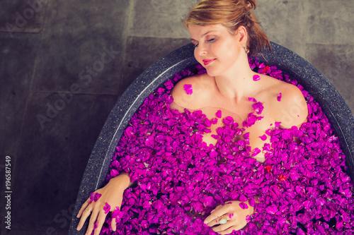 Woman relaxing in beautiful flower bath