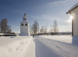 tower with an church in a winter landscape - 196590954