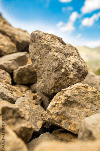 Poster Stenen Large rocks in the mountains as a background