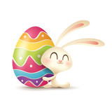 Easter bunny hugs a painted egg. - 196596781