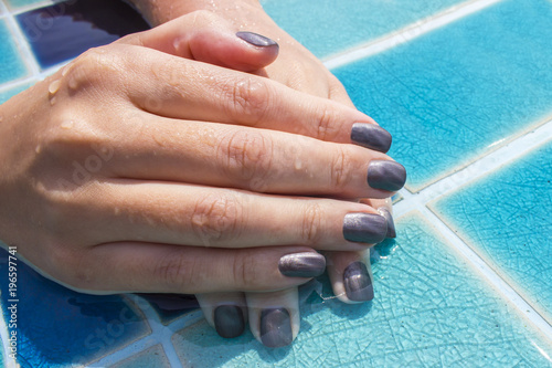 Foto op Canvas Manicure Female hands with manicure. Well-groomed hands after a spa