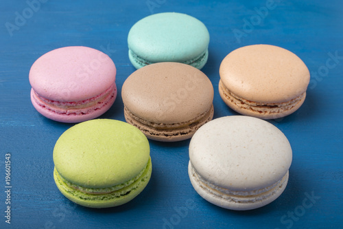 Colorful cookies. Cake macaron or macaroon on a blue background 1 Poster