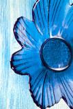 Blue flower glass plate on blue wooden board - 196603780