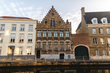 beautiful old traditional buildings near canal in brugge, belgium