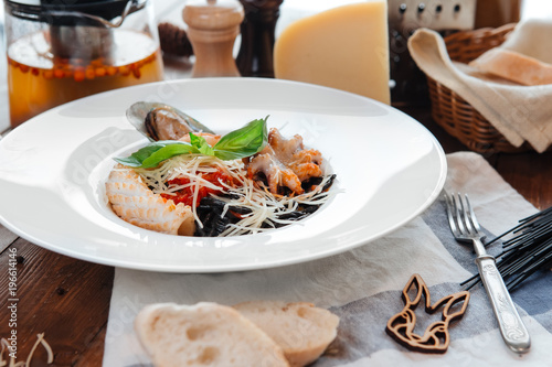 Black pasta with seafood - 196614146