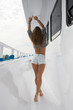 Rear view sexy woman in a ship