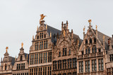 beautiful ancient buildings with sculptures in historical quarter of Antwerp, Belgium